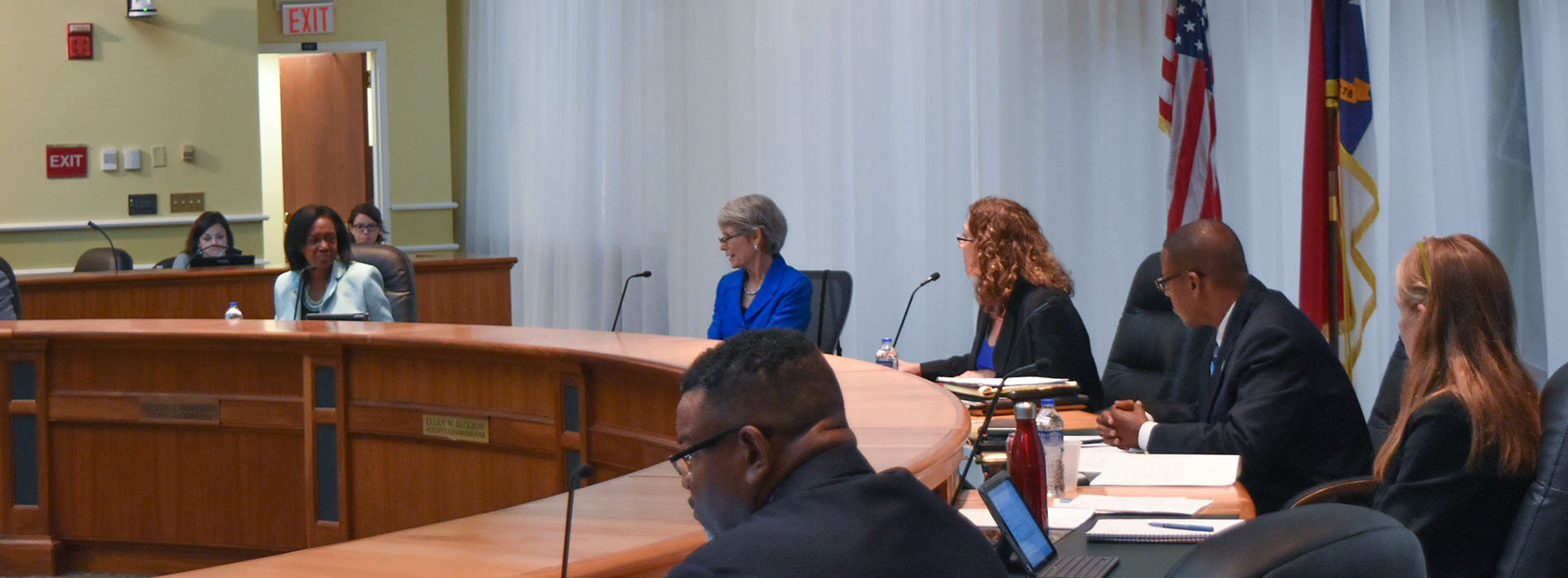 Board of County Commissioners sit at desks during meeting