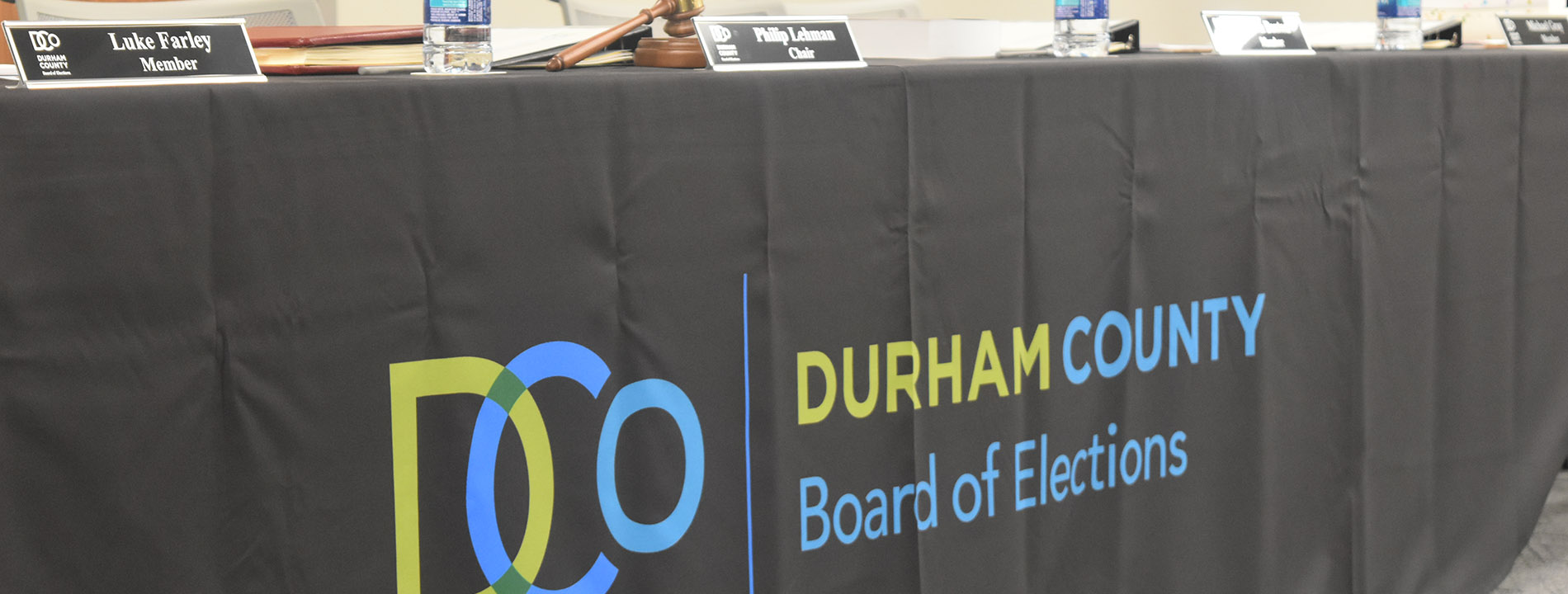 Board of Elections logo on table with gavel