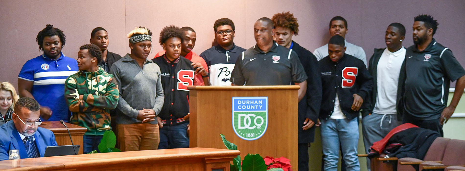 Members of the Southern High School football team stand at the December 9 BOCC meeting